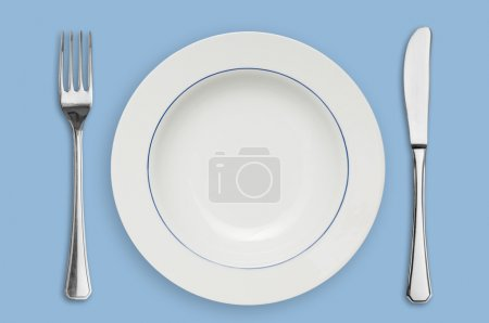 Photo for Clean placed plate with fork and knife, ready for dinner! - Royalty Free Image