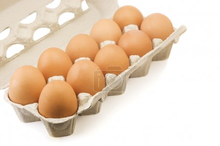 Photo for Ten brown eggs in a cardboard carton isolated on white background - Royalty Free Image