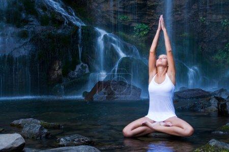 Yoga exercises near waterfall