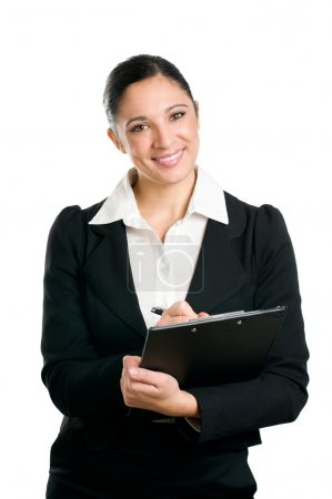 Business woman taking notes on clipboard