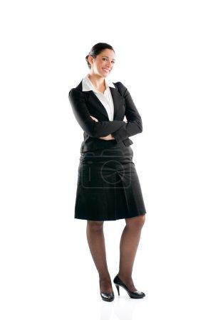 Photo pour Pleine longueur, femme d'affaires jeune permanent isolée sur fond blanc - image libre de droit