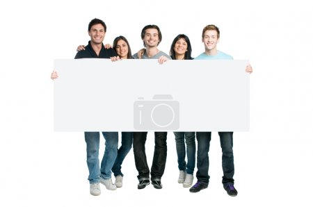 Photo for Happy young group of standing together and holding a blank sign for your text, isolated on white background - Royalty Free Image