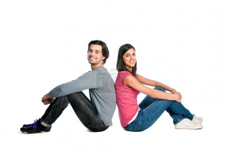 Smiling young couple sitting together