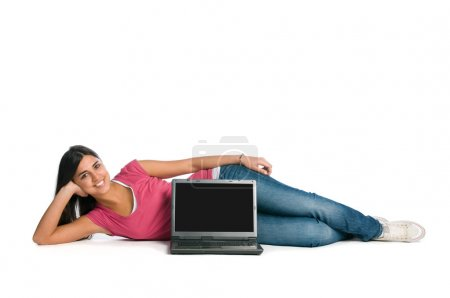 Happy smiling woman with blank laptop screen