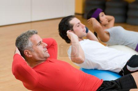 Fitness class making sit-ups