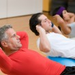 Постер, плакат: Fitness class making sit ups