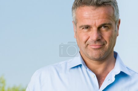 Photo for Confident mature man smiling and looking at camera - Royalty Free Image