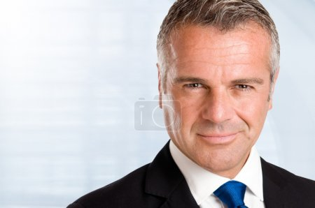 Closeup satisfied businessman