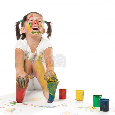 Photo for Happy smiling little girl playing and painting with colors isolated on white background - Royalty Free Image
