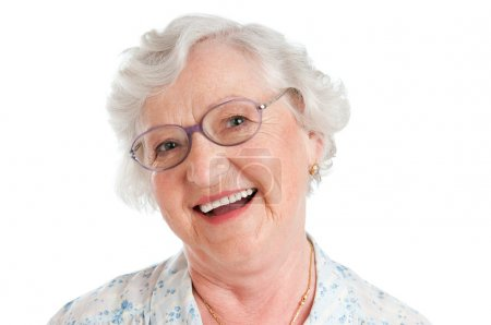 Photo pour Happy smiling senior lady looking at camera with her glasses isolated on white background - image libre de droit