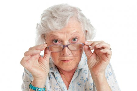 Photo pour Happy surprised old senior lady looking through her eyeglasses isolated on white background - image libre de droit