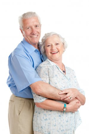 Photo for Happy smiling senior couple standing together with an embrace isolated on white background - Royalty Free Image