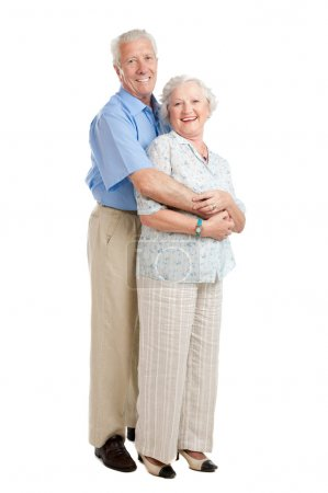 Photo for Satisfied smiling senior couple standing full length together isolated on white background - Royalty Free Image