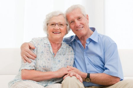Photo for Happy smiling senior couple embracing together at home - Royalty Free Image