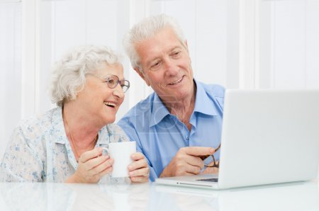 Photo for Happy elder couple enjoy together at laptop computer - Royalty Free Image