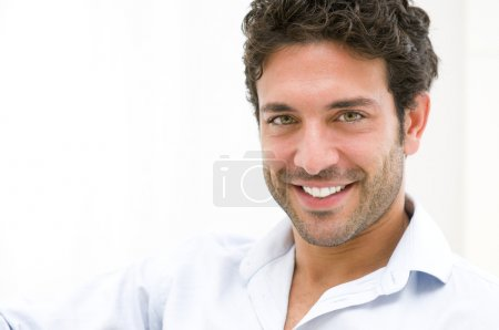 Photo for Closeup of happy young man looking at camera at home - Royalty Free Image