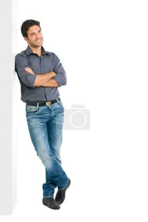 Thinking young man full length