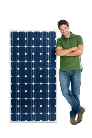 Photo for Happy smiling young man standing with a solar panel for renewable energy, isolated on white background - Royalty Free Image