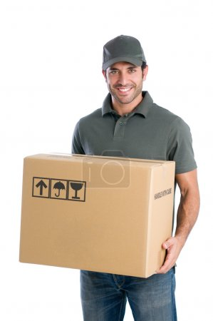Photo for Smiling young delivery man holding and carrying a cardbox isolated on white background - Royalty Free Image