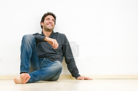 Photo for Happy smiling man looking up and dreaming at his future - Royalty Free Image
