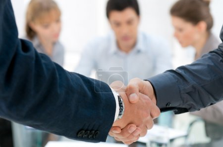 Photo for Business men shaking hands after an agreement during a meeting - Royalty Free Image