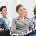 Happy business group attending an educational meet...