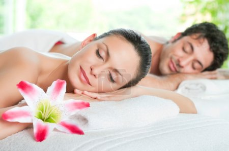 Photo for Beauty woman and man relaxing together during a spa treatment - Royalty Free Image