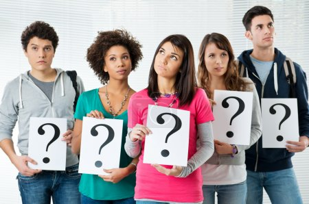 Students Holding Question Mark