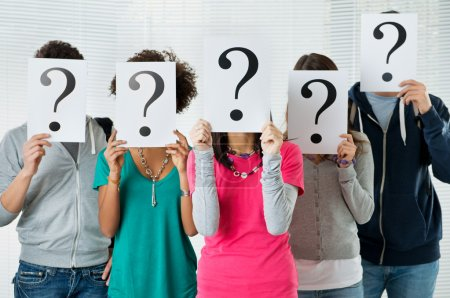 Photo for Students Hiding There Face With Question Mark Sign, uncertainty of their future concep - Royalty Free Image