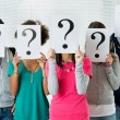 Students Hiding There Face With Question Mark Sign...