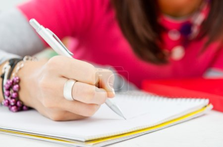 Photo for Closeup Of Student Hand Writing On Pape - Royalty Free Image