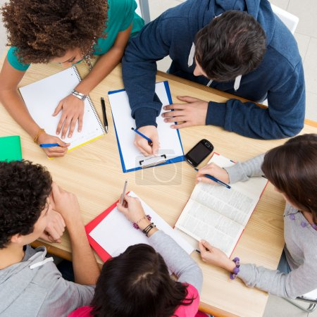 Photo for Group of young students studying together at college, high view angl - Royalty Free Image