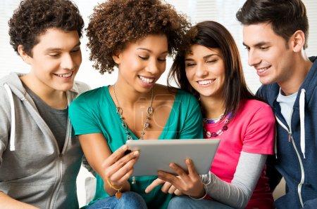 Friends Enjoying Digital Tablet