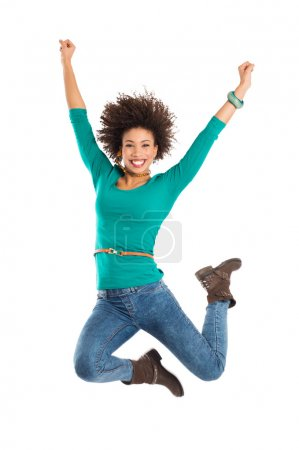 Photo for Portrait Of Gir Jumping In Joy Isolated Over White Background - Royalty Free Image