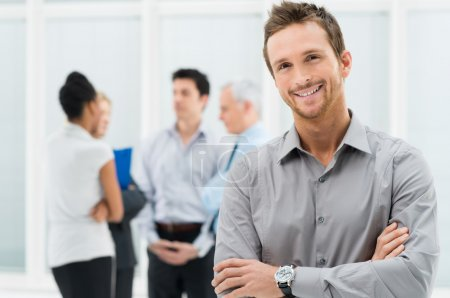 Photo for Portrait Of Young Handsome Businessman Smiling In Office - Royalty Free Image