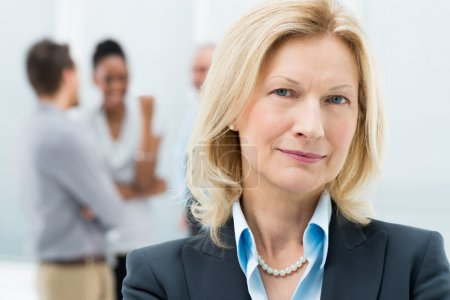 Portrait Of Happy Senior Businesswoman In Office...