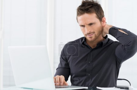 Photo for Businessman Tired Working On Laptop - Royalty Free Image