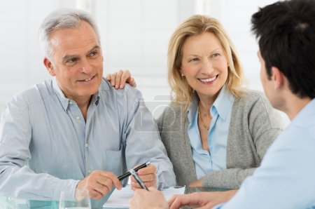 Senior Couple Talking With A Consultant