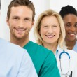 Group Of Happy Successful Doctors Standing In A Ro...