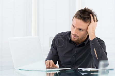 Photo for Stressed Man Working On Laptop - Royalty Free Image