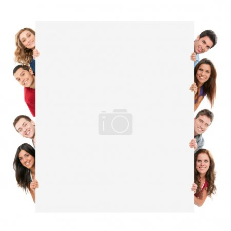 Photo for Happy smiling group of friends showing blank placard board to write it on your own text isolated on white background - Royalty Free Image