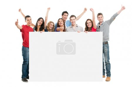 Photo for Happy joyful large group of friends diplaying white placard for your text isolated on white background - Royalty Free Image