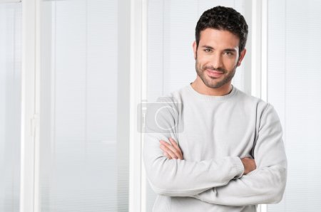 Photo for Handsome satisfied young man smiling and looking at camera - Royalty Free Image
