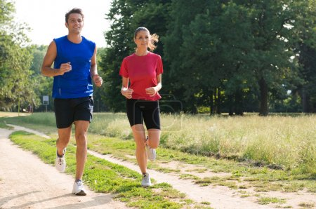 Portrait Of Young Couple Jogging