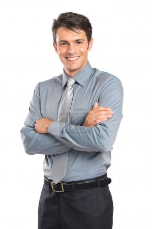 Photo for Portrait Of Happy Young Businessman With Arm Crossed Isolated On White Background - Royalty Free Image
