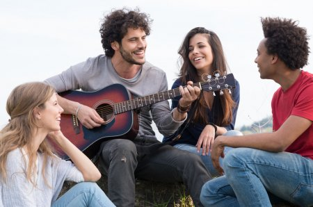 Group Of Friends With Guitar