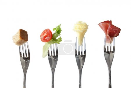Photo for Food on forks: bread, vegetable, cheese and meat - four basic nutrition - Royalty Free Image
