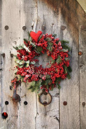 Photo for Christmas wreath on an old wood door - Royalty Free Image