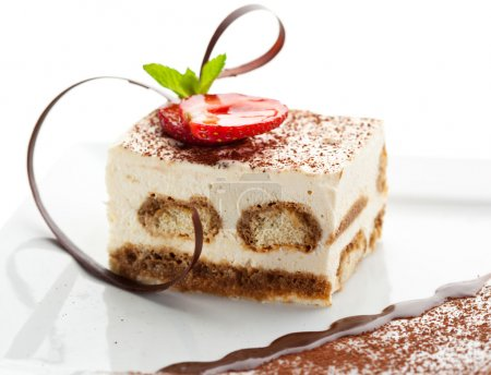 Photo for Tiramisu - Classical Dessert with Cinnamon and Coffee. Garnished with Strawberry and Mint - Royalty Free Image