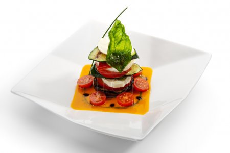 Photo for Insalata Caprese - Italian salad, made of Tomatoes, Zucchini and Buffalo Mozzarella Cheese - Royalty Free Image